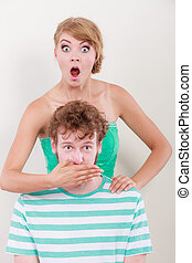 surprised couple wide eyed girl covering mouth her man -...