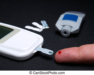 Blood sugar testing - Closeup view of testing of blood...