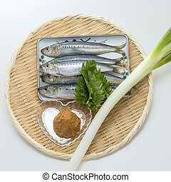 Fresh raw sardine capelin fish with onion and wasabi on...