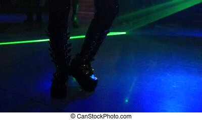 Boots in disco dancing - Woman in metal boots dancing in...