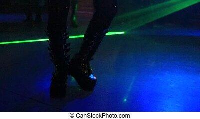 Boots in disco dancing - Woman in metal boots dancing in...