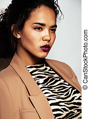 beauty young afro woman in zebra print sweater close up,...