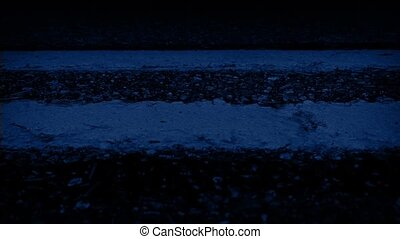 Moving Along Road Markings At Night - Closeup tracking shot...