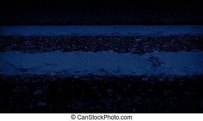 Moving Along Road Markings At Night - Closeup tracking shot...