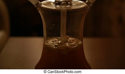 glass shisha closeup - Beautiful glass shisha closeup in the...