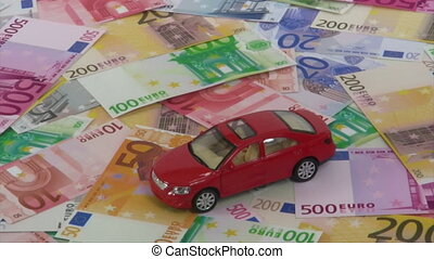 Buy or rent a car - Model car rotating on euro bank notes