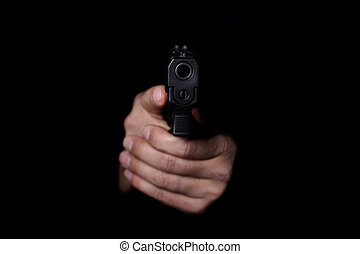 Man's hands aiming with gun.