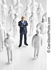 Businessman and faceless figurines - Businessman figurine...