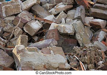 Bricks in a dumpster near a construction site, home...