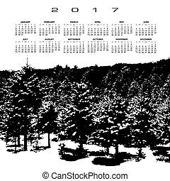 A 2017 calendar with a snow covered pine forest in black and...