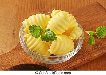 fresh butter curls - Curls of fresh butter in glass bowl