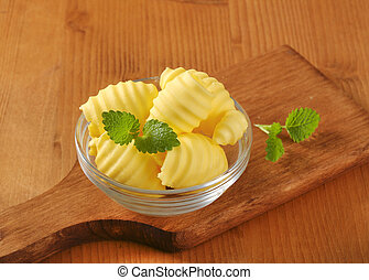 fresh butter curls - Curls of fresh butter in glass bowl