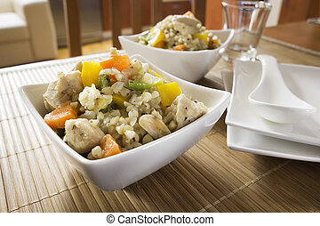 Risotto with vegetable, meat, fresh herbs and parmesan...