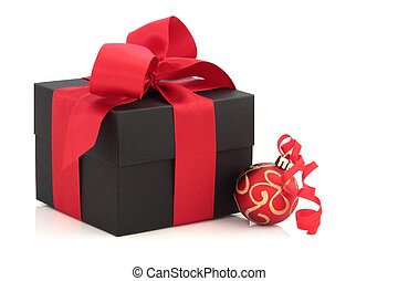 Christmas Present and Red Bauble - Christmas gift box tied...