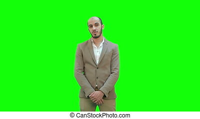 Businessman presenting project looking at camera on a Green Screen, Chroma Key.