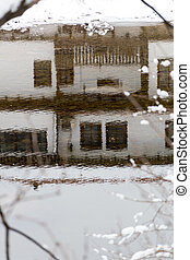 Rippled reflection of a traditional Bulgarian house