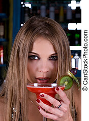 Clubbing girl - Beauty young woman portrait with a glass...
