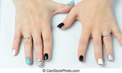 Female hand with trendy manicure. Nail design on a white...