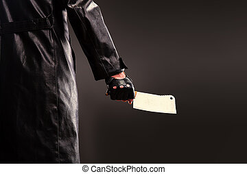 Killer holding meat cleaver in hand. - Killer in black...