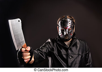 Murderer in hockey mask with meat cleaver in hand - Murderer...