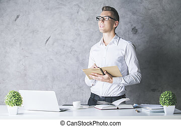 Attractive guy with notepad