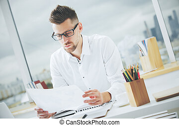 Handsome male with document - Portrait of handsome european...