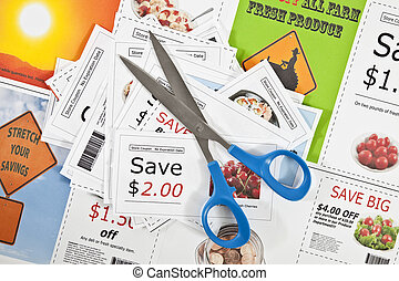 Fake coupons on a fake coupon background with scissors -...