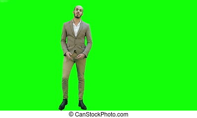 Businessman presenting project to the camera on a Green...