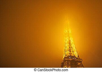 Eiffel Tower, Paris, France. - Night,foggy view of Eiffel...