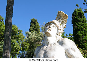 Statue of Achilles trying to remove the arrow from his hill.