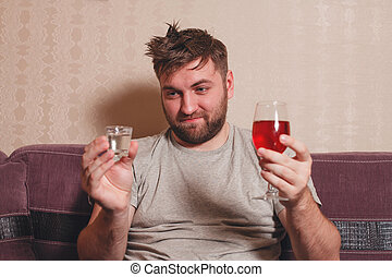 Alcohol addicted man choose drink for hangover