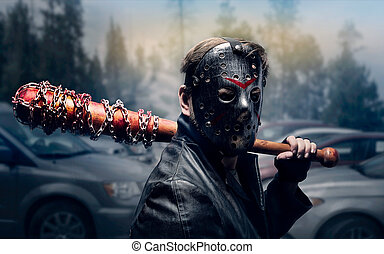 Bloody maniac in hockey mask and black leather coat with...