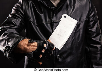 Maniac with knife on dark background - Serial maniac with...