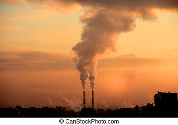 Building and smokie - Smoke from industrial chimneys at dawn