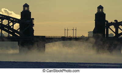 Road bridge over the frozen river in winter. A closeup of...