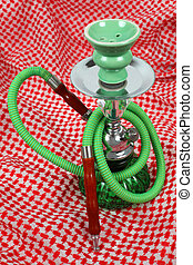 Water pipe on traditional Arabic cloth