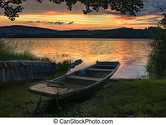 Landscape with boat - Rowboat on beautiful lake with...