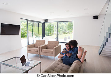 young multiethnic couple relaxes in the living room - Young...