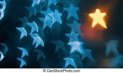 Defocused lights of garland in the night