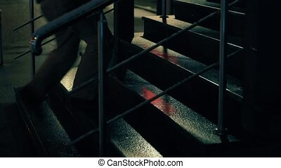 The man's foots moving up and down the steps - The man's...