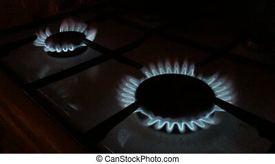 kitchen gas burners in the dark - domestic kitchen gas...