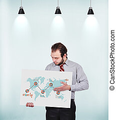 start up strategy - businessman holding poster with drawing...