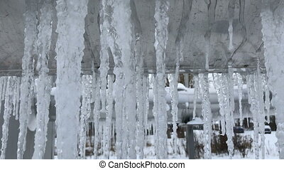 Icicles on a large metal tube closeup