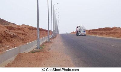 Road on the Desert - Asphalt Road on the Desert. Car is...