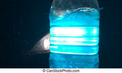 Automotive wiper fluid - Blue liquid in a plastic bottle at...