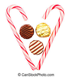 Christmas candy canes - Heart made of candy canes with three...
