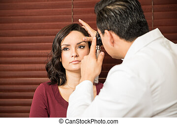 Woman getting a checkup with doctor - Portrait of a pretty...