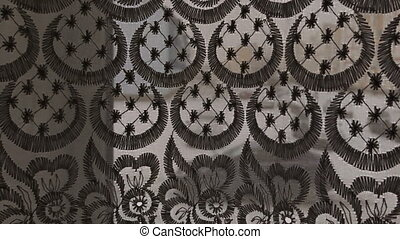 curtains close-up smooth movement. The pattern on the...