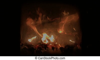 flames in the fireplace behind smoked glass - The flames in...