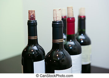 bottle of red wine on table closeup